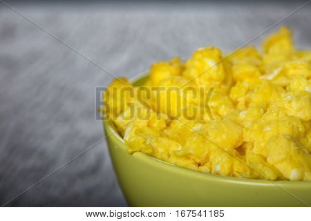 Close up of bowl filled with scrambled eggs