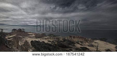 A Pacific storm approaches the cliffs at Torrey Pines in San Diego, California.