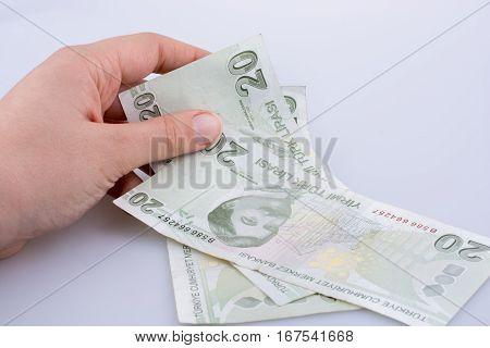 Hand Holding 20 Turksh Lira Banknote  In Hand