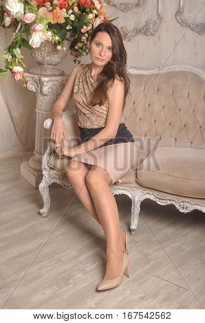 Young beautiful girl sitting relaxing on the couch