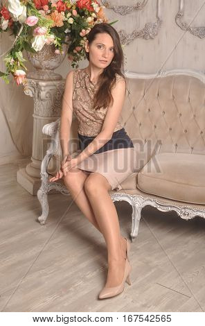 Young girl sitting on a retro couch