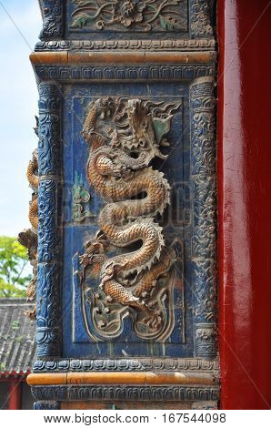 Decorative Dragon on the wall in the Shenyang Imperial Palace Mukden Palace, Shenyang, Liaoning Province, China. Shenyang Imperial Palace UNESCO world heritage site built in 400 years ago.