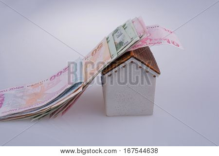Turkish Lira Banknotes On The Roof Of A Model House
