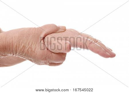 Hands of elderly woman suffering from pain in wrist on white background, closeup