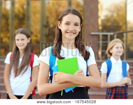 Teenage girl and her friends going to school
