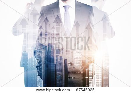 Businesspeople on abstract city with arrows background. They are thinking about financial growth. Double exposure