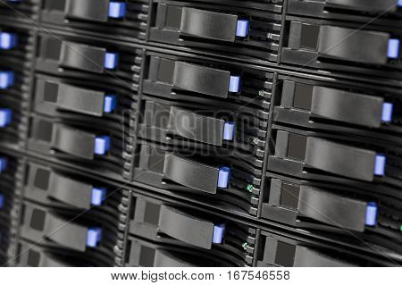 Closeup of hard drives in large SAN storage at datacenter
