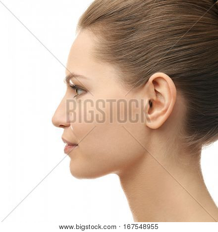 Young beautiful woman on white background. Plastic surgery concept