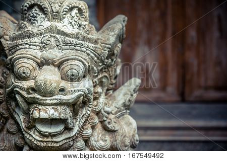 Terrible Asian buddhism demon face with copy space in vintage style