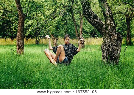 Beautiful Stylish Hipster Girl Levitating With Peaceful Feelings In Apple Garden In Summer