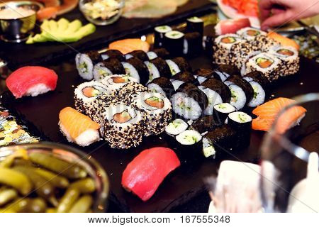 Stylish Luxury Decorated Tables With Sushi Rolls For Birthday Celebration, Cathering In The Restaura