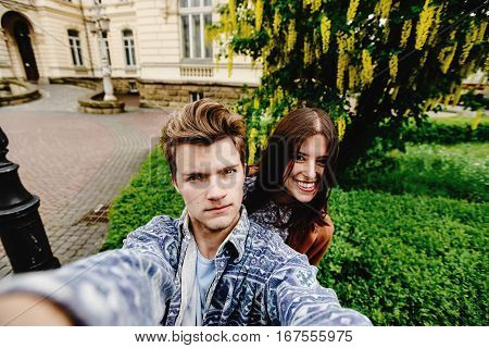 Stylish Happy Hipster Couple Having Fun Traveling And Taking Selfies In The Old City In Europe In Su