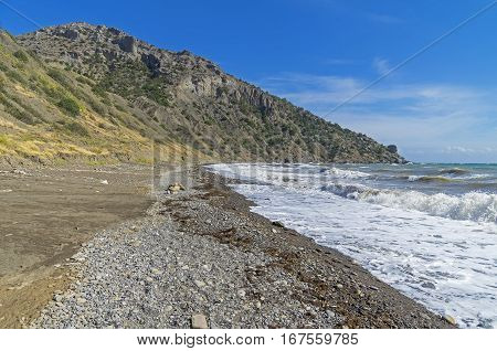 Strong surf on an empty beach. Crimea September.