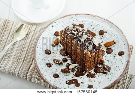 Delicious sweet chocolate Spartak cake on a rustic plate. Haute cuisine dessert. International food. Top view.