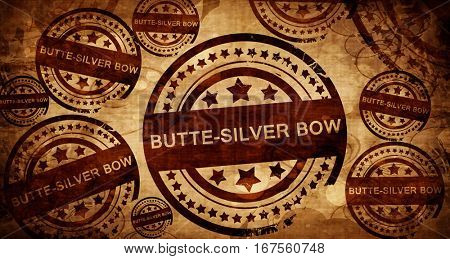 butte-silver bow, vintage stamp on paper background