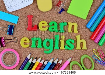 Learn english words on cork background closeup