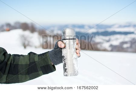 Man Holding A Thermos On Hiking Trip