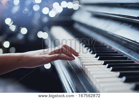 girl playing on an old piano vintage