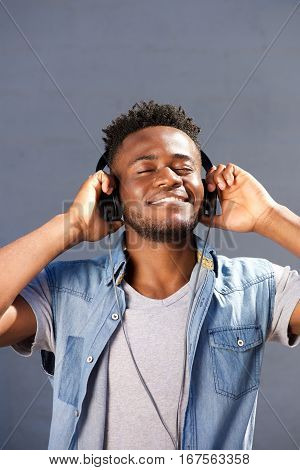 Happy Smiling Man Enjoying Music With Headphones