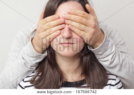 Guy the girl closes her eyes. Waiting for a surprise or secret disclosure