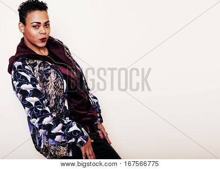 young pretty mulatto woman with modern haircut fancy dressed, posing smiling, fashion concept