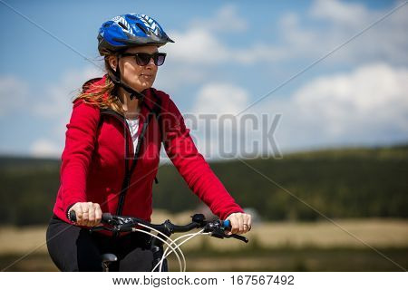 Middle-aged woman riding bicycle