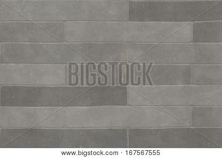 Detail of a wall of a long gray brick.