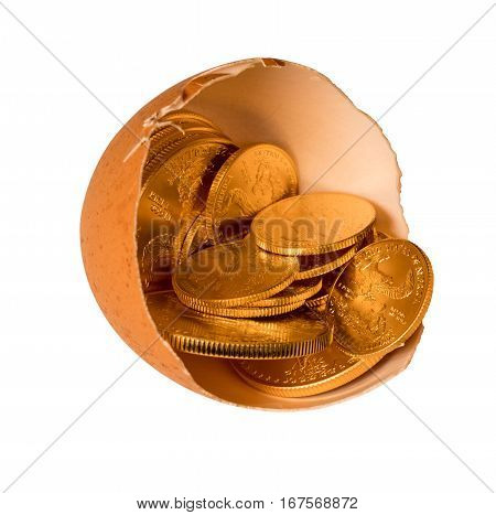 Isolated selection of pure gold USA treasury coins in broken egg shell with path illustrating financial security of a retirement nest egg