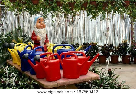 BEER SHEVA ISRAEL - APRIL 20 2009: Gnome and watering cans in the interior of flower shop