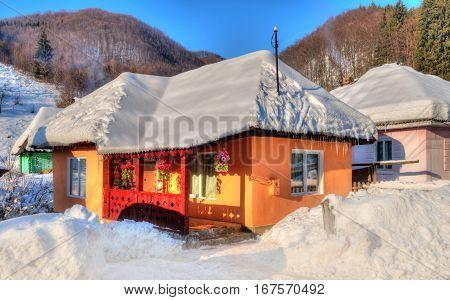 Beautiful and traditional house from Transylvania, in Firiza village,  winter season - Romania