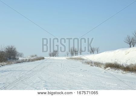 Car driving on snowy winter road