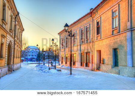 Traditional architecture of Baia Mare, city of Transylvania, in center square at sunset - Romania