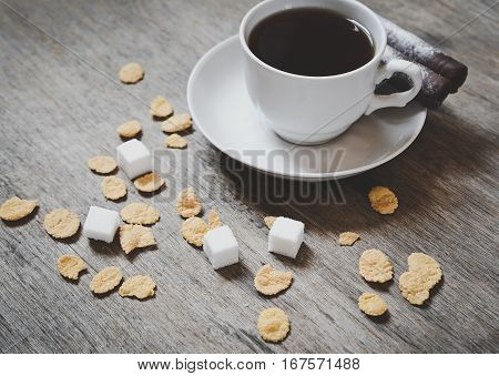 cop of coffee with sugar cubes on the wooden table. healthy breakfast abstract