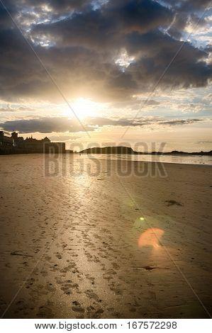 Dramatic sunset view on sandy Saint-Malo coast, Bretagne France