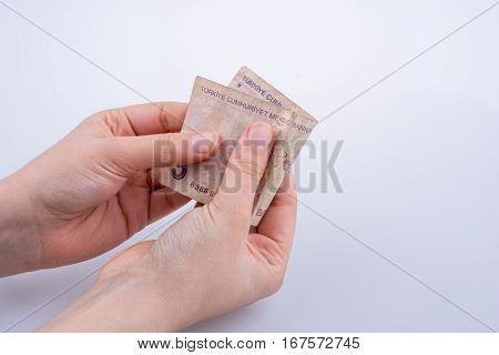 Hand Holding 5 Turksh Lira Banknote  In Hand