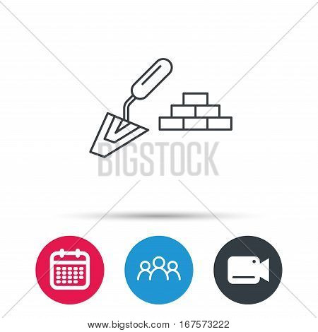 Finishing icon. Spatula with bricks sign. Group of people, video cam and calendar icons. Vector