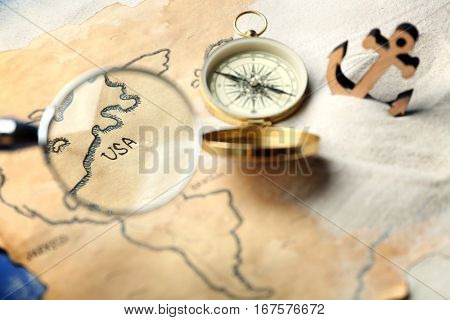 View at old map through magnifier. Columbus Day concept