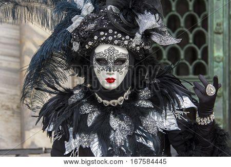 VENICE, ITALY - FEBRAURY 2: Carnival of Venice beautiful mask in Saint Mark Square FEBRUARY 2, 2016 in Venice, Italy