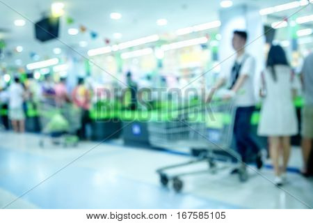 Blur checkout counter in supermarket