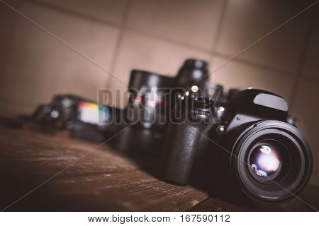 Background of professional reflex camera on wooden boards