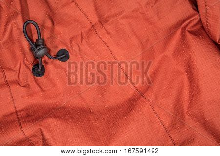 Wet Rain Coat with Adjustment Cord Background Image