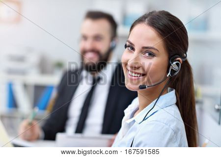 Picture showing pretty woman in call center