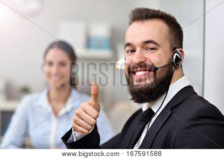 Picture showing happy man in call center