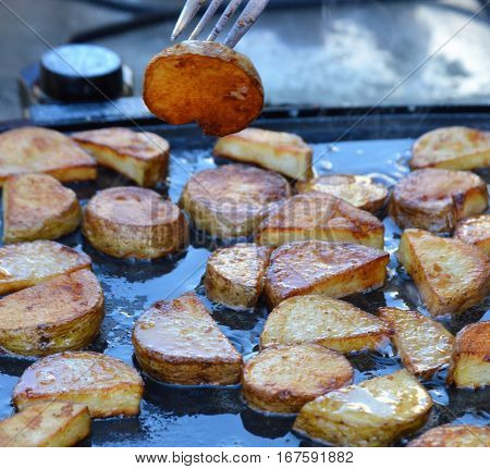 on a fork portable griddle breakfast potatoes cooking oil round slices