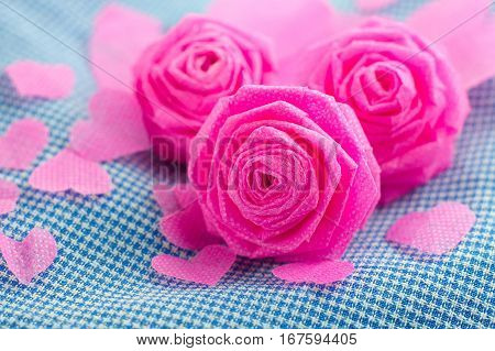 Pink rose and small hart on blue cloth background for Valentine festival. vintage color style