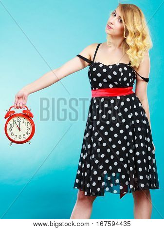 Serious Girl With Alarm Clock On Blue.
