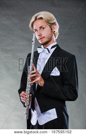 Elegantly Dressed Musician Holding Flute