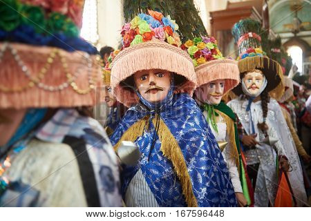 People In Big Colorful Mask