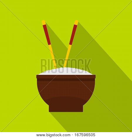 Brown bowl of rice with pair of chopsticks icon. Flat illustration of bowl of rice with pair of chopsticks vector icon for web on green background