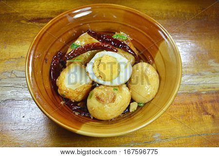 fried egg with sweet and sour sauce on bowl